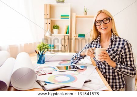 Young Smiling Designer Having Break And Drinking Coffee