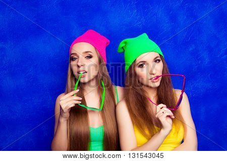 Portrait Of Stylish Women Holding Glasses  On Blue Background