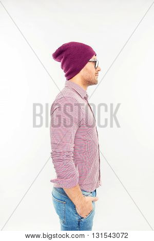 Handsome Man In Hat And Glasses Holding Hands In Pockets, Side View Photo
