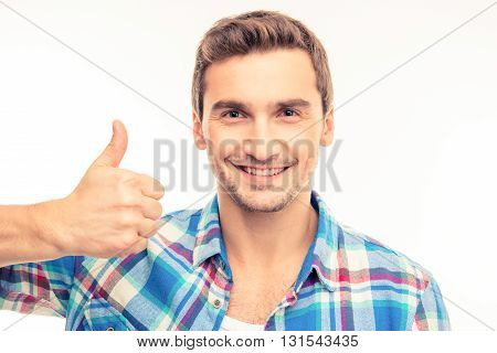 Portrait Of A Cute Handsome Young Man Showing Thumb Up