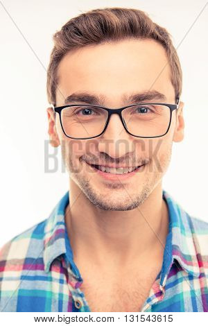 Handsome happy man with his glasses  on a white background