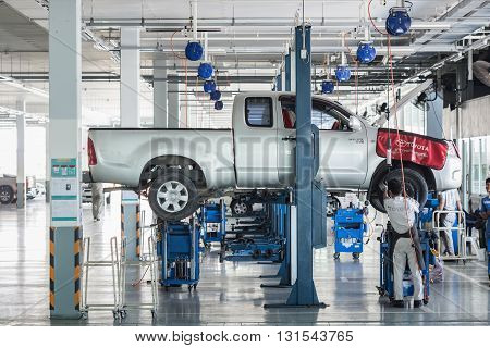 PHUKET THAILAND - APRIL 19 : Car technician repairing car in workshop service station in Phuket on March 19 2016. The official dealer of Toyota who is the top market share for commercial car.