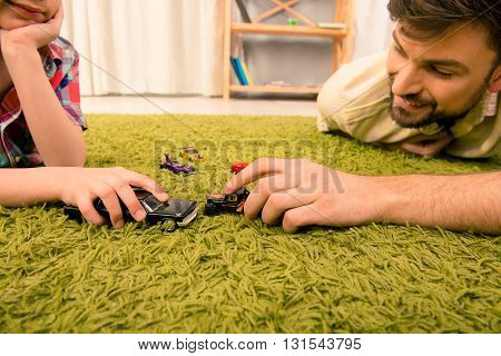 Close Up Photo Of Happy Family Playing With Toy Cars