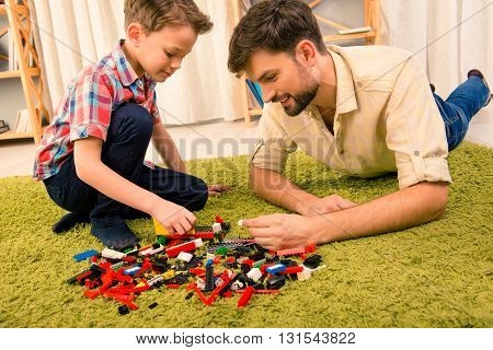 Leisure Time. Excited Father And Son Playing With Constructor