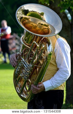 Man in costume playing the instrument Tuba