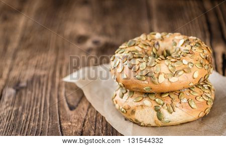 Wooden Table With Fresh Baked Wholemeal Bagels