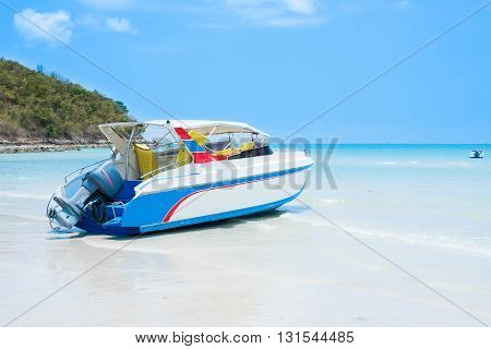 soft focus boat on the beach with blue sky