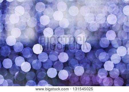 Blurring lights bokeh background of blue circles