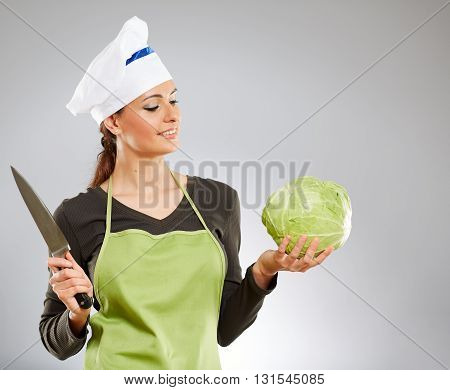Woman Cook Holding A Cabbage