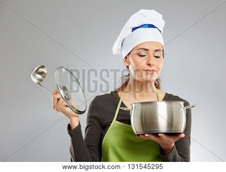 Woman Cook With A Pot