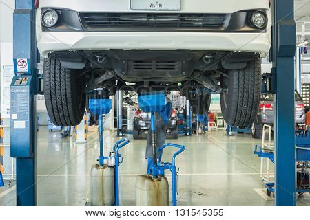 Phuket, Thailand - April 22 : Car Technician Repairing Car In Workshop Service Station In Phuket On
