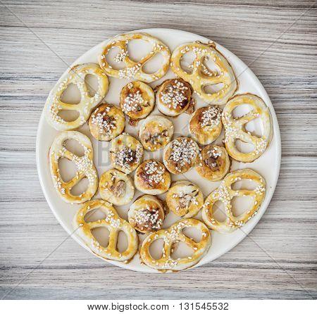 Tasty sesame pastries on the round plate. Food theme. Sesame snacks. Refreshments theme.