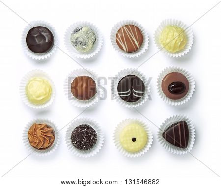 Chocolate truffles in paper, isolated on white background