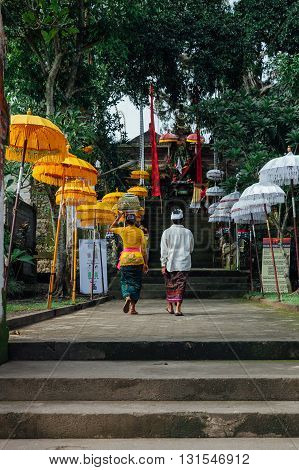 Balinese Family In Traditional Clothes  Going To The Temple, Ubud, Bali