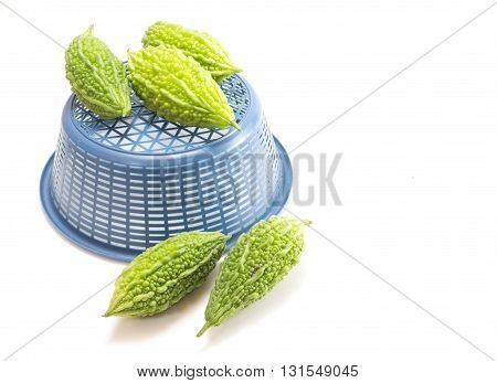 Bitter melon or Bitter gourd with basket on white background