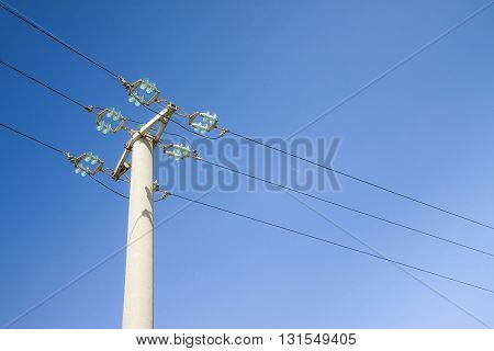 Typical concrete electricity pylon in the Tuscany countryside - Italy