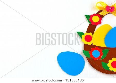 Decorative basket with eggs from a cardboard - Easter background. Easter crafts for children.