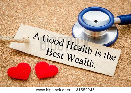 A good health is the best wealth card and stethoscope with red heart on wood table. Medical concept.