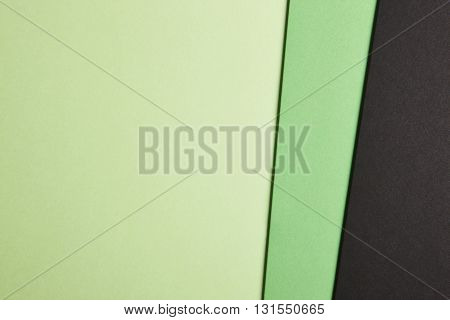 Colored cardboards background in green black tone. Copy space. Horizontal