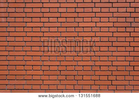 wall of bricks - red clinker brick in natural light