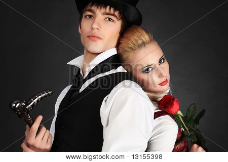 Portrait of the elegant young couple in medieval era costumes. Shot in a studio.