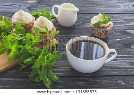 Homemade Sweet Mint Cupcake With Cream And Cup Of Coffee