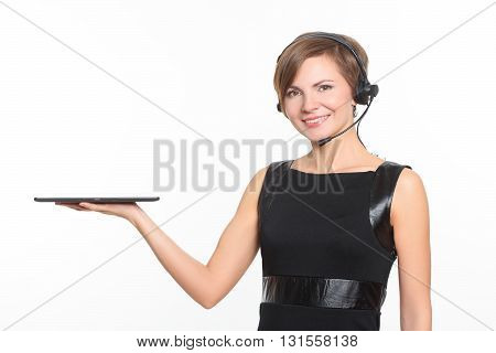 young brunette woman with a headset and a tablet on a white background
