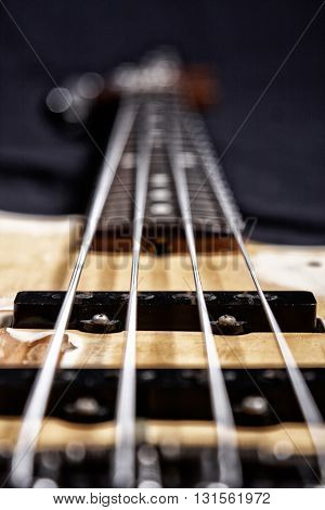 Electric bass guitar closeup focus on the magnet