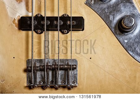 Closeup of electrical bass guitar focus on the magnet