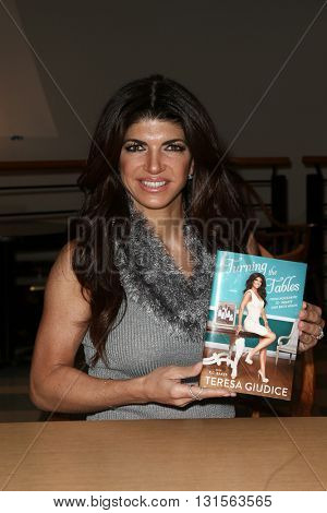 NEW YORK-FEB 16: TV personality Teresa Giudice signs copies of her book,