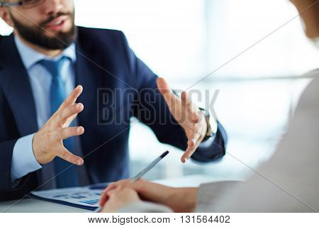 Manager showing estimated earning growth to his colleague