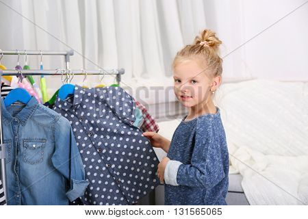Little girl trying on a new dress