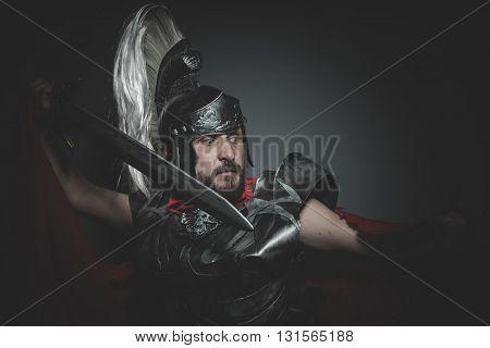 Hero, Praetorian Roman legionary and red cloak, armor and sword in war attitude