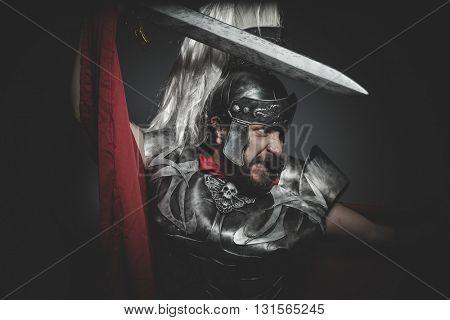 Military, Praetorian Roman legionary and red cloak, armor and sword in war attitude