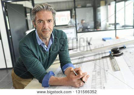 Portrait of smiling mature architect in office