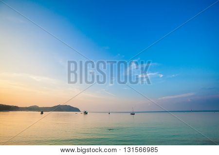 Beautiful sunset on tropical island Koh Phangan in Thailand. Chaloklum beach landscape.