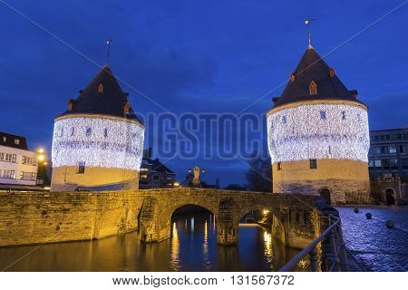 Broel Towers along the river Lys during Christmas in Kortrijk in Belgium