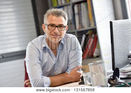 Portrait of businessman sitting in office