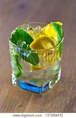Cocktail With Lemon And Peppermint Leaves