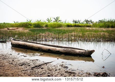 Traditional dugout wooden canoe on the Mono's river shore in  Heve, Benin, Africa