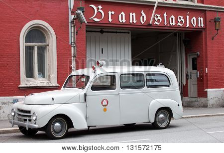 BERGEN, NORWAY - may 15, 2012: Vintage Volvo car of  fire brigade of Bergen in front of the building of brandstation