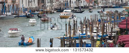 ITALY, VENICE - JUNE 27, 2013: View of Grand canal with intensive traffic of water vehicles