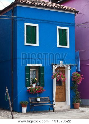 VENICE, ITALY - JUNE 28, 2013: One of the bright houses of the Burano island