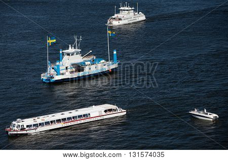 SWEDEN, STOCKHOLM - JUNE 05, 2011: Touristic ferries, sightseeing ships and boats in Strommen strait in Saltsjon bay in Stockholm