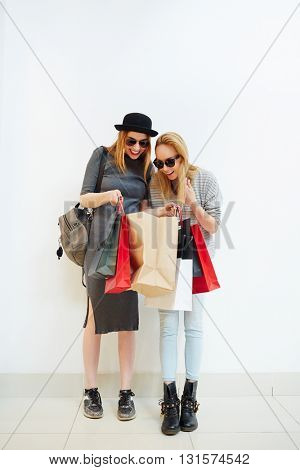 Woman showing purchase to her friend