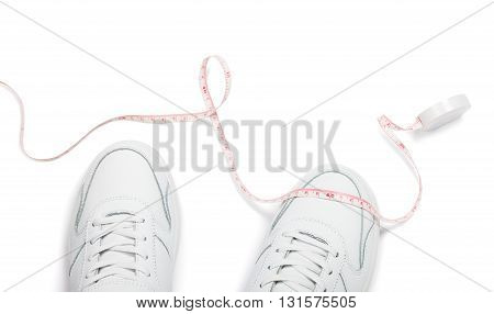 Two sneakers and meter over white background. Loss weight concept image