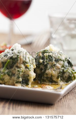 two italian strangolapreti spinach dumplings with wine