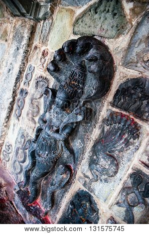 Detail of a carved wall dedicated to Shiva in Belur temple Karnataka India