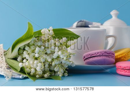 Spring Tea Drinking With White Flowers  On Blue Background