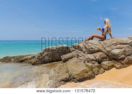 Woman In Bikini With Orange Cocktail On The Beach